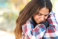 Teenager girl worried and sad outdoors Stock Photo
