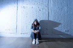 Teenager girl or young woman feeling sad and scared looking overwhelmed and depressed Royalty Free Stock Images