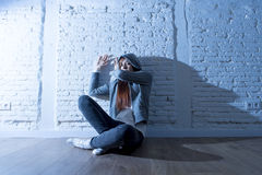 Teenager girl or young woman feeling sad and scared looking overwhelmed and depressed Stock Images