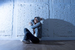 Teenager girl or young woman feeling sad and scared looking overwhelmed and depressed Royalty Free Stock Image