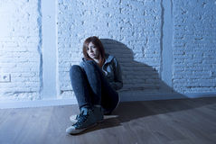 Teenager girl or young woman feeling sad and scared looking overwhelmed and depressed Royalty Free Stock Photos