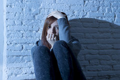 Teenager girl or young woman feeling sad and scared looking overwhelmed and depressed Stock Photos