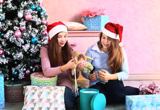 Teenager girls with christmas tree and presents Royalty Free Stock Photo
