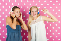 Teenager girls with headphones Stock Photos
