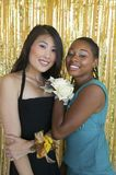 Teenager girls hugging at school dance Royalty Free Stock Photo