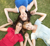 Teenager Girls Looking Up Into Camera. Group Of Teenager Girls Looking Up Into Camera Royalty Free Stock Images
