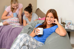 Teenager girls drinking at slumber party Royalty Free Stock Photography