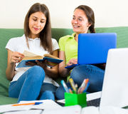 Teenager girls studying at home Stock Photo