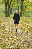 Teenager girls walks in autumn park Stock Photography