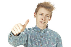 Teenager gives thumps up and smiles Stock Image