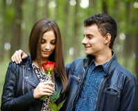 Teenager giving a flower to his girlfriend Stock Photography