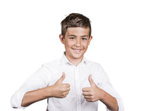 Teenager giving thumbs up gesture. Portrait Happy casual young, handsome man showing thumb up, smiling isolated white background. Positive human emotions, facial Stock Photos