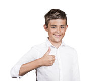 Teenager giving thumbs up gesture. Portrait Happy casual young, handsome man showing thumb up, smiling isolated white background. Positive human emotions, facial Royalty Free Stock Images