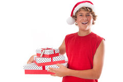 Teenager giving Xmas Gifts Stock Images