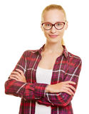 Teenager with glasses and her arms crossed Royalty Free Stock Photography
