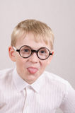 Teenager in glasses showing tongue Stock Photography