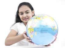 Teenager with a globe Royalty Free Stock Photo