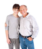 Teenager and grandfather, in studio Royalty Free Stock Photography