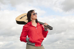 Teenager with guitar Royalty Free Stock Image