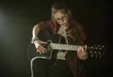 Teenager with guitar. Beautiful teenager playing skustic guitar Royalty Free Stock Photography