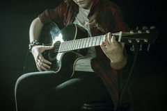 Teenager with guitar. Beautiful teenager playing skustic guitar Stock Photos