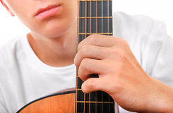 Teenager with Guitar Closeup Stock Images