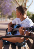 Teenager with a guitar Royalty Free Stock Photo
