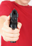 Teenager with a gun in his hand Royalty Free Stock Photos