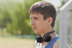 Teenager guy with wireless headphones Royalty Free Stock Photos