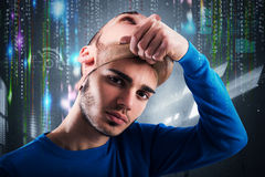 Teenager hacker. Teenager takes off the mask of adult Royalty Free Stock Images
