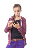 Teenager hacks on her smart phone Royalty Free Stock Images