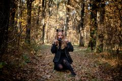 Teenager in Halloween costumes in the woods stock images