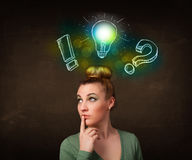 Teenager with hand drawn light bulb illustration Stock Photo