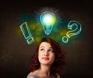 Teenager with hand drawn light bulb illustration Royalty Free Stock Image
