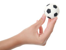 Teenager hand holding sport ball Stock Photo