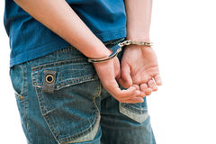 Teenager in handcuffs Royalty Free Stock Image