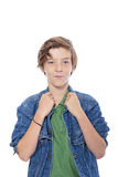 Teenager with hands on his jacked collar. Smiling male  teenager with hands on his jacked collar, isolated on white Stock Photography