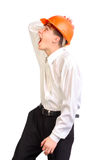 Teenager in hard hat. The teenager in old and damaged hard hat Stock Photos