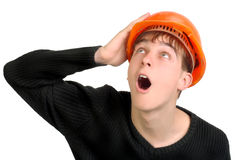 Teenager in hard hat Stock Image