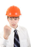 Teenager in Hard Hat showing his Fist. Serious Teenager in Hard Hat showing his Fist Isolated on the white Background Royalty Free Stock Photos