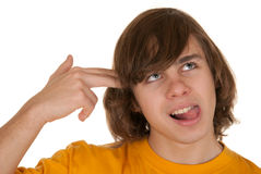 Teenager has put hand fingers to head Stock Image