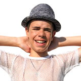 Teenager in a hat on white Royalty Free Stock Image