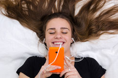 Teenager have fun with mobile Royalty Free Stock Images
