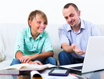 Teenager having lesson with teacher Stock Image