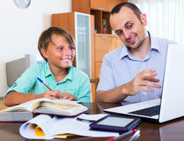 Teenager having lesson with teacher Royalty Free Stock Image