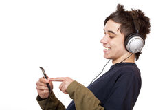 Teenager with headphone use mp3 music player Royalty Free Stock Image