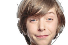Teenager with headphones hurts the music. Male teenager with headphones hurts the music, isolated on white Royalty Free Stock Image