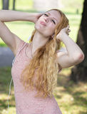 Teenager with headphones listening music Royalty Free Stock Photo