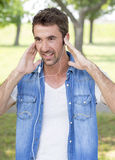 Teenager with headphones listening music Stock Photography