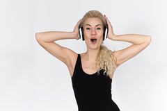 Teenager with Headphones Listening to the Song and Sings Royalty Free Stock Image